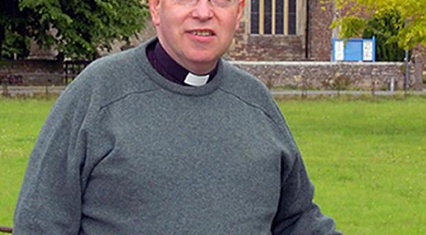 The Rev John Suddards, 59, was found stabbed to death in the hallway of his home on St Valentine's Day