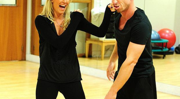 Denise Van Outen and James Jordan mess around during their training for Strictly Come Dancing