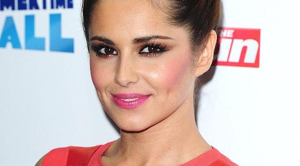 Cheryl Cole said she warned her boyfriend not to jump on the trampoline