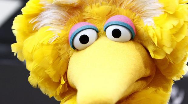 Mitt Romney said he would cut funding for PBS, the network behind Sesame Street favourite Big Bird (AP)