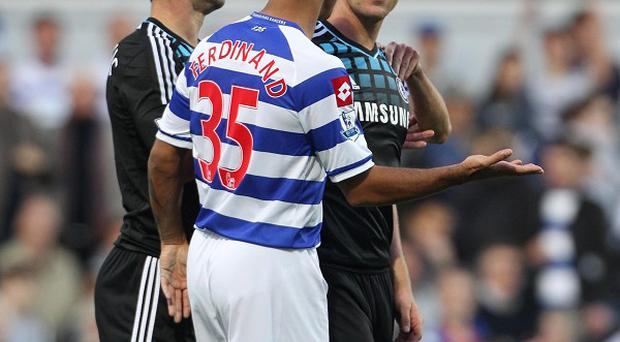 Chelsea captain John Terry speaking with QPR's Anton Ferdinand during a match at Loftus Road