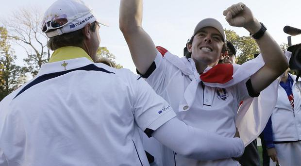 Rory McIlroy, right, was relieved to get to Medinah on time for his singles contest (AP)
