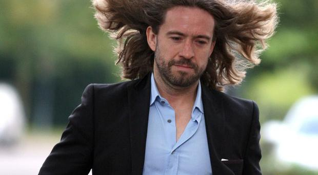 TV star Justin Lee Collins denies harassing his former girlfriend