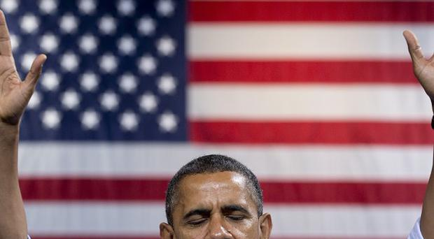 President Barack Obama speaks at a campaign event at George Mason University in Fairfax, Virginia (AP)