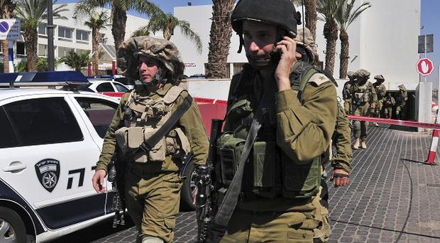 Israeli soldiers secure the area near the site of a shooting incident at a hotel in the Red Sea resort of Eilat (AP)