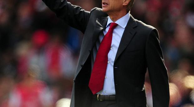 Arsene Wenger says referees should be left to do their job