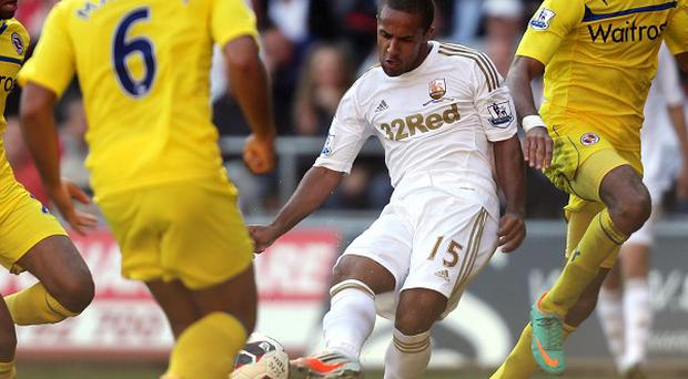 Wayne Routledge, centre, scored 12 minutes from time earn a point against Reading