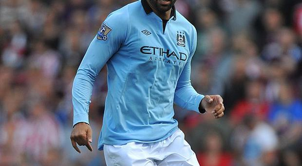 Joleon Lescott, pictured, has received the backing of team-mate Micah Richards