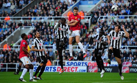 NEWCASTLE UPON TYNE, ENGLAND - OCTOBER 07: Man United player Jonny Evans scores the first goal the Barclays Premier league game between Newcastle United and Manchester United at Sports Direct Arena on October 7, 2012 in Newcastle upon Tyne, England. (Photo by Stu Forster/Getty Images)
