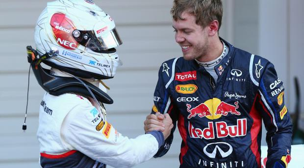 SUZUKA, JAPAN - OCTOBER 07: Race winner Sebastian Vettel (R) of Germany and Red Bull Racing congratulates third placed Kamui Kobayashi (L) of Japan and Sauber F1 in parc ferme following the Japanese Formula One Grand Prix at the Suzuka Circuit on October 7, 2012 in Suzuka, Japan. (Photo by Clive Rose/Getty Images)