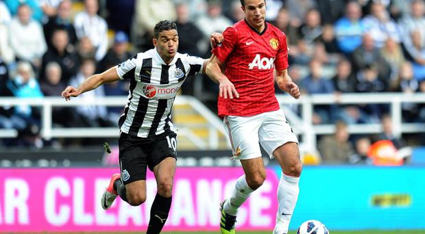 Manchester United's Robin van Persie (right) and Newcastle United's Hatem Ben Arfa battle for the ball during the Barclays Premier League match at the Sports Direct Arena, Newcastle