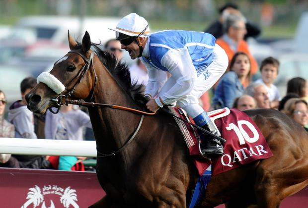 Olivier Peslier steers 33-1 Arc winner Solemia across the line at Longchamps