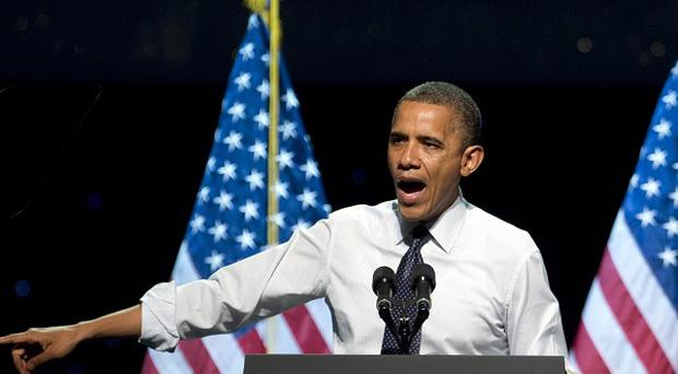 US President Barack Obama speaks at a campaign event at the Nokia Theatre in Los Angeles (AP)