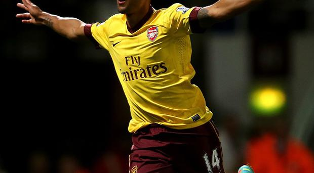 Arsenal's Theo Walcott celebrates scoring his side's second goal at Upton Park