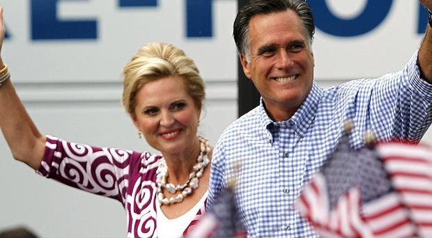 Mitt Romney and his wife Ann arrive at a campaign rally in Port St Lucie, Florida (AP)