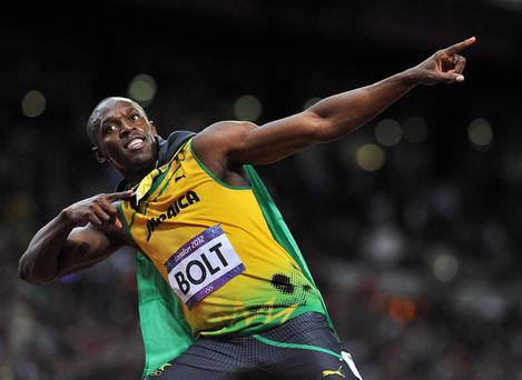 File photo dated 05/08/2012 of Jamaica's Usain Bolt celebrating winning the Men's 100m final at the Olympic Stadium, London. Bolt has revealed he plans to defend his Olympic sprint titles in Rio de Janeiro in 2016 and not switch disciplines