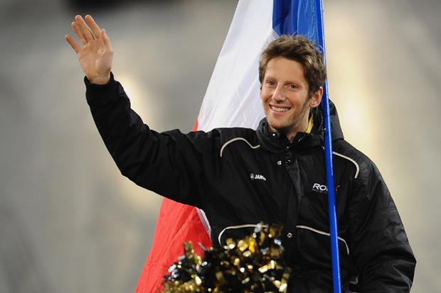 Romain Grosjean ran into the back of Mark Webber's car on the opening lap of Sunday's Japanese Grand Prix in Suzuka