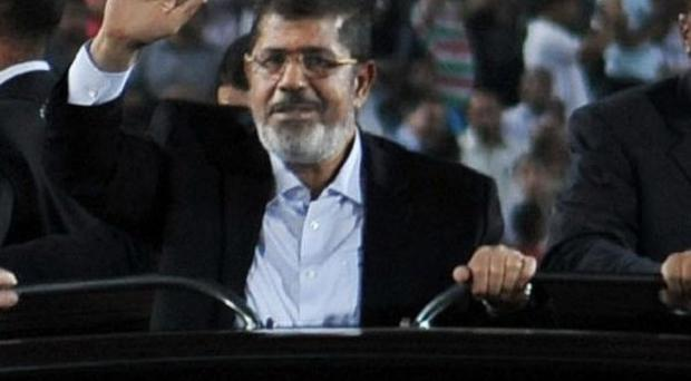 Mohammed Morsi was sworn in as Egypt's president on June 30 (AP/Egyptian Presidency)