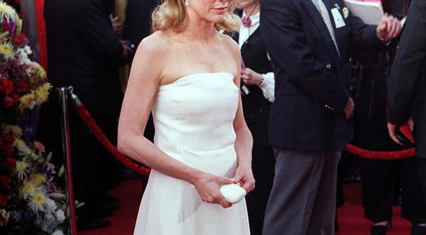 Kim Basinger will apparently play Liam Neeson's wife in The Third Person