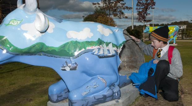Smashed: Jack Mellon (11) looks at the Cow Parade artworks which have been smashed by vandals