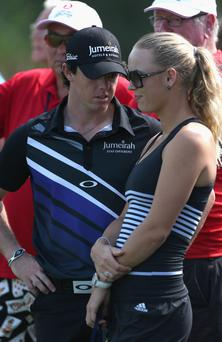 ANTALYA, TURKEY - OCTOBER 09: Rory McIlroy of Northern Ireland speaks with his girlfriend Caroline Wozniacki of Denmark, the World's Number One female tennis player during day one of the Turkish Airlines World Golf Final at Antalya GC on October 9, 2012 in Antalya, Turkey. (Photo by Warren Little/Getty Images)