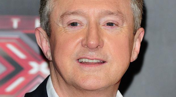 X Factor producer Richard Holloway was seen talking to Louis Walsh during Sunday night's show