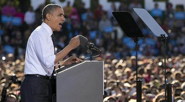 Barack Obama speaks at a campaign event at The Ohio State University Oval, in Columbus, Ohio (AP/Carolyn Kaster)
