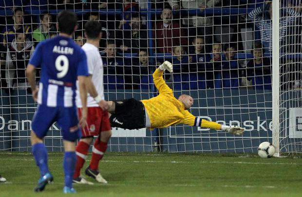 Linfield goalkeeper Alan Blayney is a relieved man as Curtis Allen's free kick hits the post