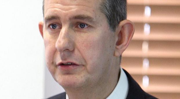 Health Minister Edwin Poots joined other MLAs as they tried to steer marbles around an obstacle course using only their brooms