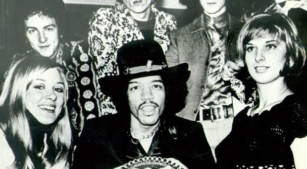 Rock legend Jimi Hendrix is presented with a birthday cake on the night he played the Whitla Hall in 1967