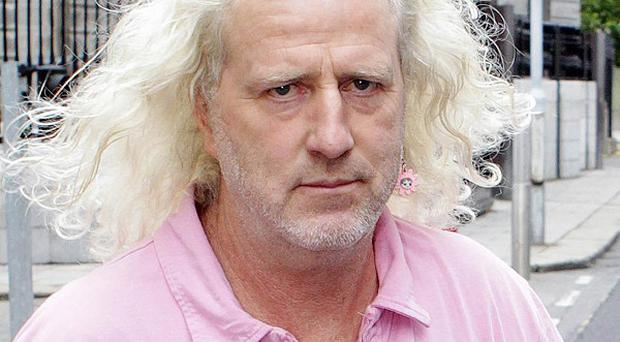 TD Mick Wallace admits he threatened to hire a hitman