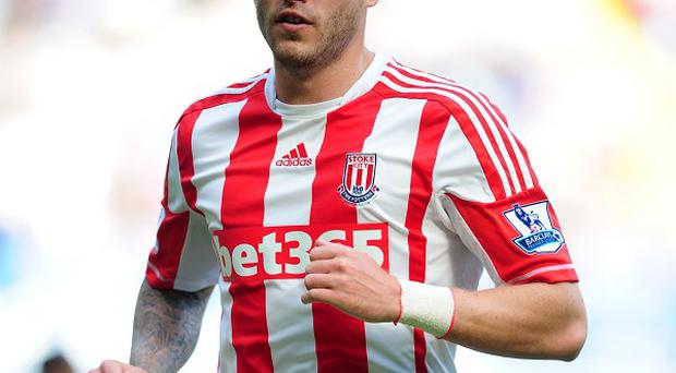 Michael Kightly, pictured, wants referees to stamp down on diving after the Luis Suarez incident