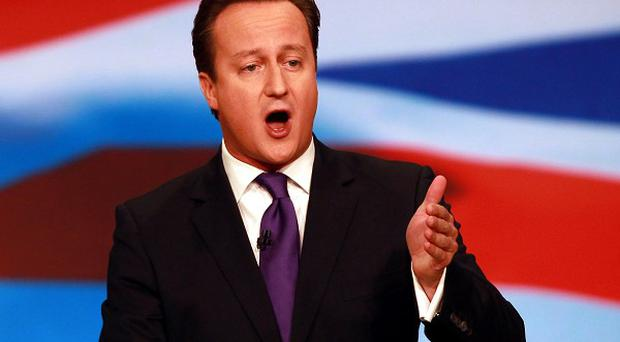 Prime Minister David Cameron addresses the Conservative Party's annual conference