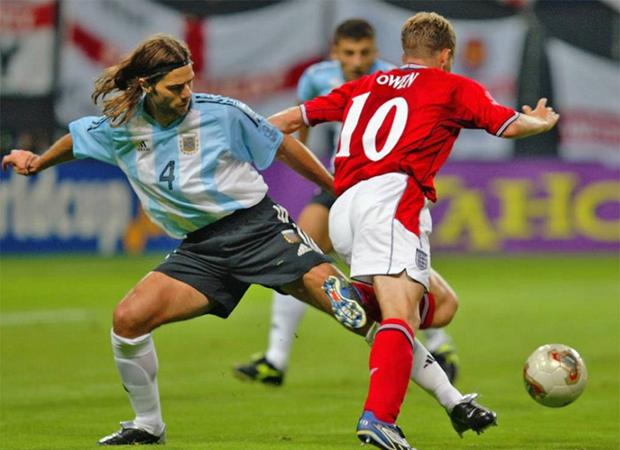 Michael Owen takes a tumble against Argentina in 2002