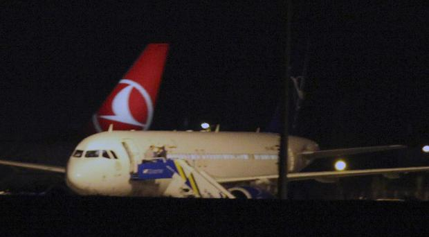 The Syrian passenger plane that was forced by Turkish jets to land at Esenboga airport in Ankara, Turkey (AP/Burhan Ozbilici)