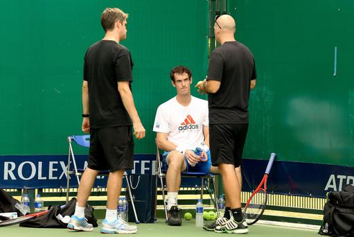 SHANGHAI, CHINA - OCTOBER 09: Andy Murray of Great Britain talks to Andy Ireland and Jez Green after his practice during the Shanghai Rolex Masters at the Qi Zhong Tennis Center on October 9, 2012 in Shanghai, China. (Photo by Matthew Stockman/Getty Images)