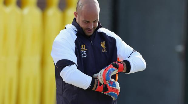 LIVERPOOL, ENGLAND - OCTOBER 03: Pepe Reina of Liverpool puts his gloves on as he walks out to a training session ahead of their UEFA Europa League match against Udinese Calcio at Melwood Training Ground on October 3, 2012 in Liverpool, England. (Photo by Clive Brunskill/Getty Images)