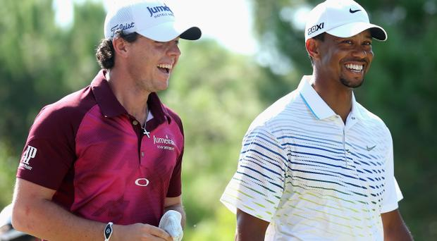ANTALYA, TURKEY - OCTOBER 11: Rory McIlroy of Northern Ireland and Tiger Woods of the USA share a joke on day three of the Turkish Airlines World Golf Final at the Antalya GC on October 11, 2012 in Antalya, Turkey. (Photo by Warren Little/Getty Images)