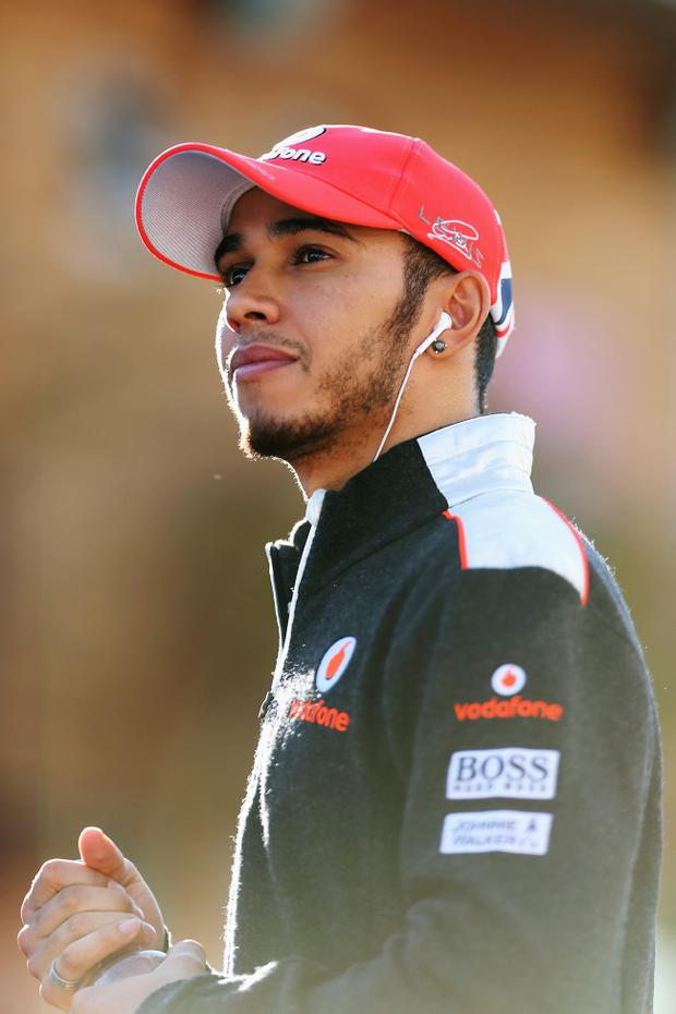 YEONGAM-GUN, SOUTH KOREA - OCTOBER 11: Lewis Hamilton of Great Britain and McLaren walks in the paddock during previews for the Korean Formula One Grand Prix at the Korea International Circuit on October 11, 2012 in Yeongam-gun, South Korea. (Photo by Mark Thompson/Getty Images)