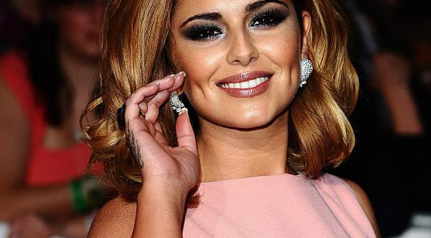 Cheryl Cole is about to reunite with her Girls Aloud bandmates