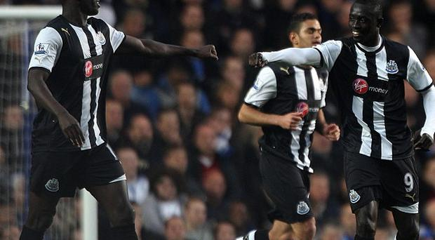 Papiss Cisse, right, and Demba Ba, left, are among the Newcastle players who could be affected by the Magpies' new shirt sponsors