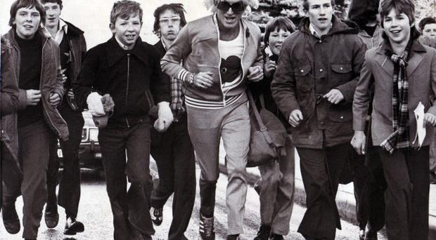 Jimmy Savile during a sponsored charity walk in Belfast on the Ravenhill Road in November 1976