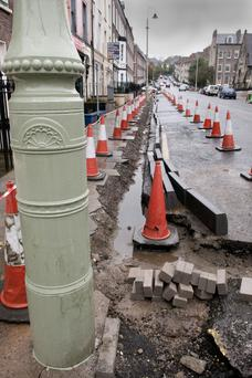 Clarendon Street in Derry where kerb stones are being replaced an new lamp posts erected