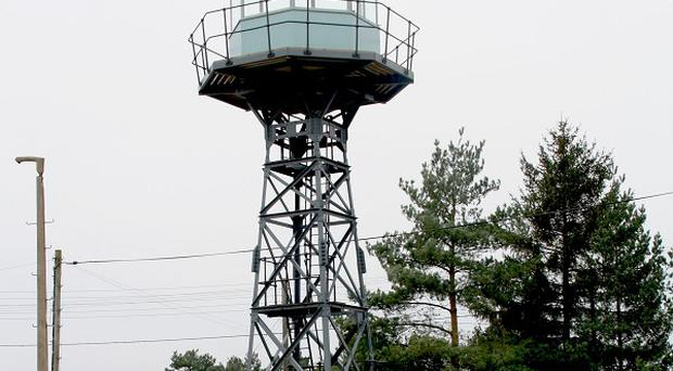 A tower at the UK's first atomic bomb store on Thetford Heath, Suffolk, is one of many buildings at risk of being lost, says English Heritage