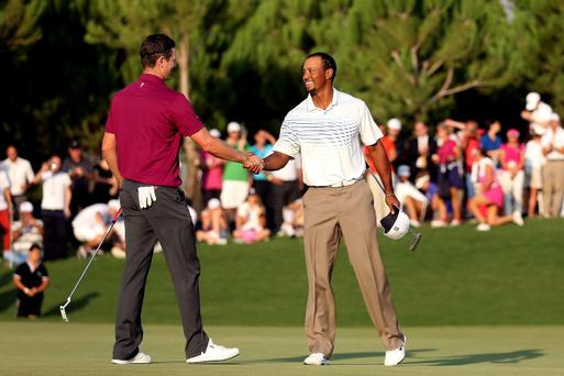 ANTALYA, TURKEY - OCTOBER 11: Justin Rose of England is congratulated by Tiger Woods of the after their match on day three of the Turkish Airlines World Golf Final at the Antalya GC on October 11, 2012 in Antalya, Turkey. (Photo by Warren Little/Getty Images)