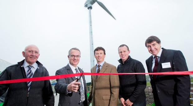 Farmers Matt Millar (second from right) and Jim McCord (left) with Simple Power's Chief Executive, Paul Carson, chairman Harry McCracken and Environment Minister Alex Attwood at the official opening