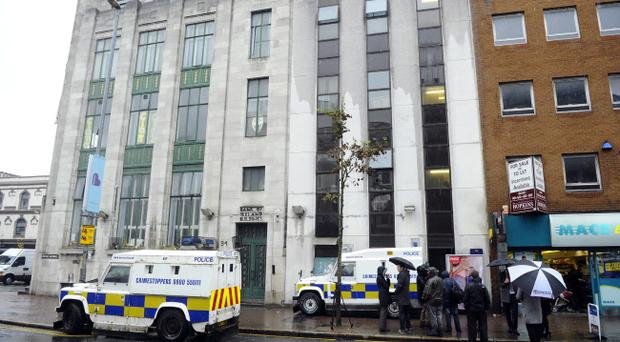 Police officers entered the building following an incident in the street