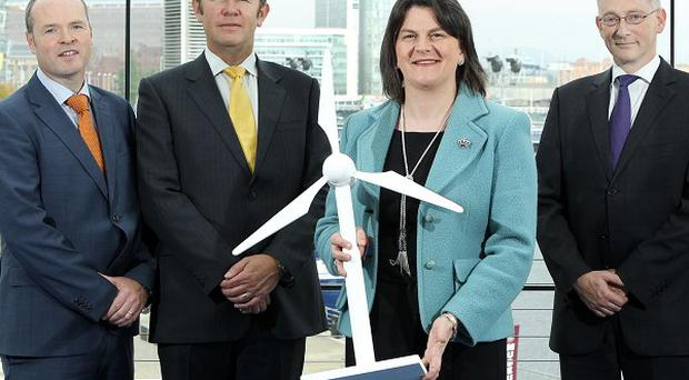 Energy Minister Arlene Foster with other parties involved in a new offshore power generation deal