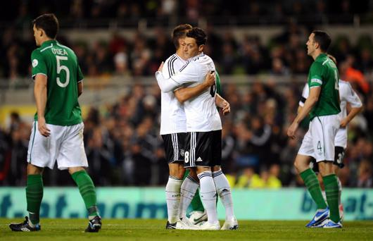 DUBLIN, IRELAND - OCTOBER 12: Mesut Oezil of Germany celebrates with Miroslav Klose after scoring his teams third goal during the FIFA 2014 World Cup Qualifier group C match between Republic of Ireland and Germany at Aviva Stadium on October 12, 2012 in Dublin, Ireland. (Photo by Lars Baron/Bongarts/Getty Images)