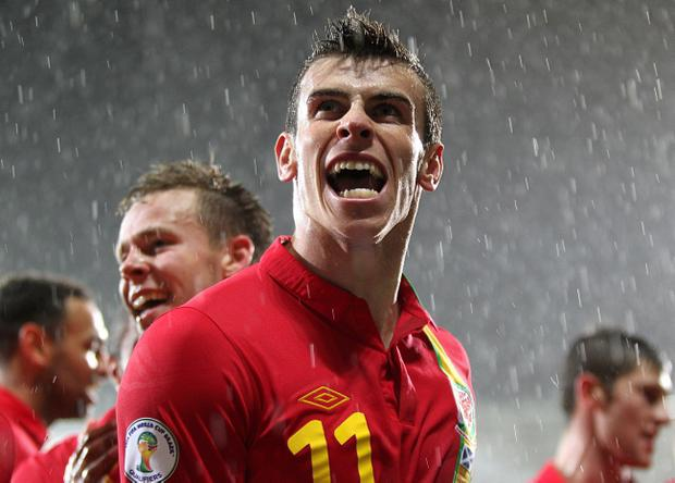Wales's Gareth Bale celebrates scoring his side's second goal of the game against Scotland during the 2014 FIFA World Cup Qualifying match at Cardiff City Stadium, Cardif